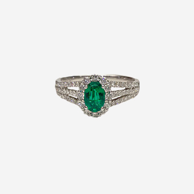18kt Triple Shank Diamond Halo and Oval Emerald Ring