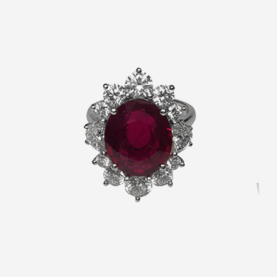Platinum Oval Ruby and Diamond Halo Ring