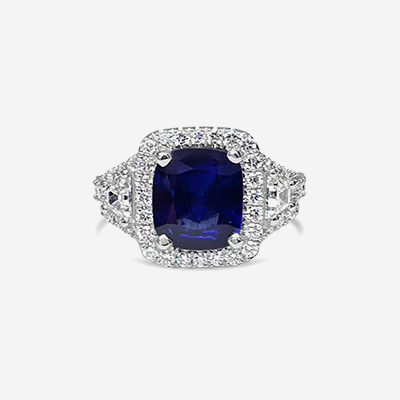 Platinum Cushion Shaped Sapphire and Diamond Engagement Ring