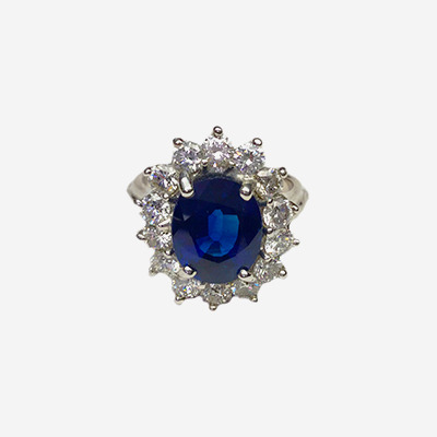 14kt Oval Sapphire and Diamond Halo Ring