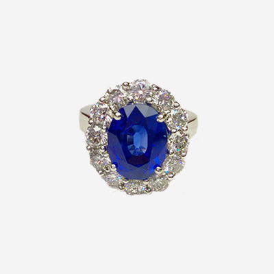 Platinum Oval Sapphire and Diamond Halo Ring