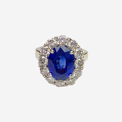 Platinum Oval Sapphire and Diamond Halo Ring