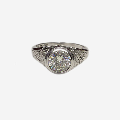 18kt Bezel Set Round Diamond with Scroll Design