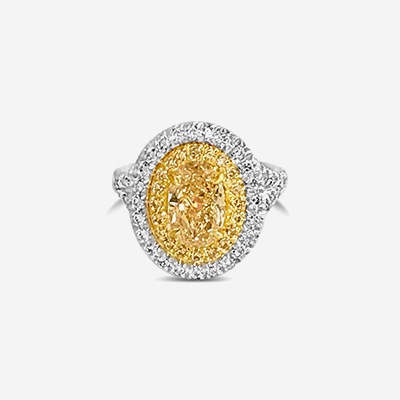 Platinum fancy yellow diamond halo ring