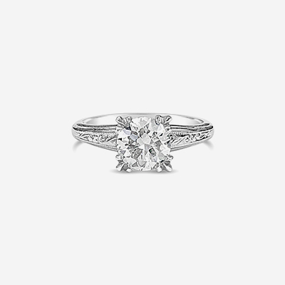 Platinum scroll diamond engagement ring