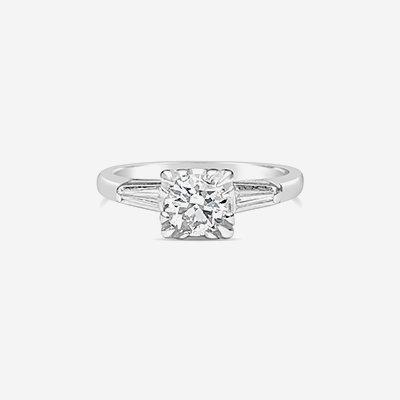 Platinum and tapered baguette diamond engagement ring