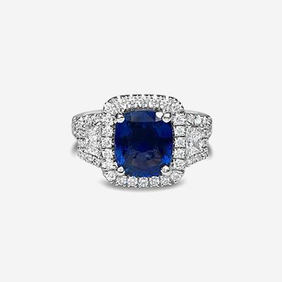 Platinum 3 Stone Cushion Sapphire and Diamond Halo Ring