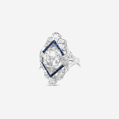 Platinum euro center diamond and sapphire ring