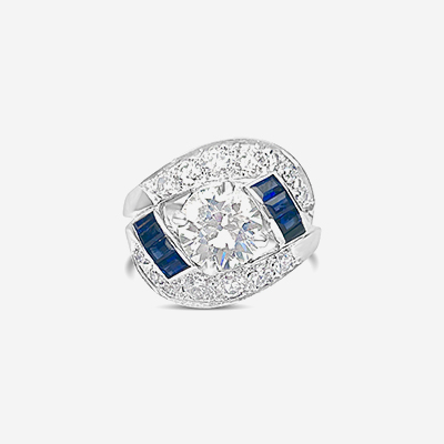Platinum round diamond and sapphire ring