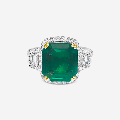18kt emerald and diamond halo ring