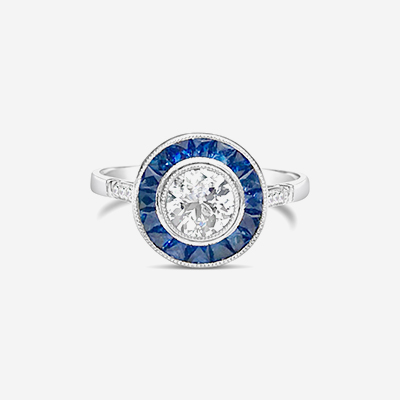 Platinum diamond and sapphire halo ring