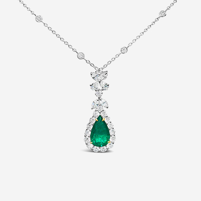18kt emerald and diamond halo pendant