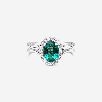 14kt oval emerald and halo diamond ring