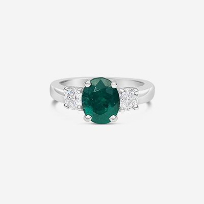 Platinum emerald and diamond engagement ring