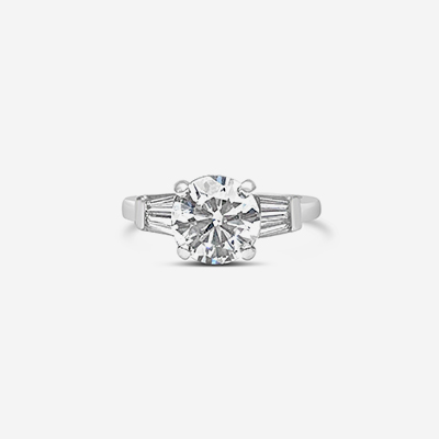 platinum round and baguette diamond engagement ring