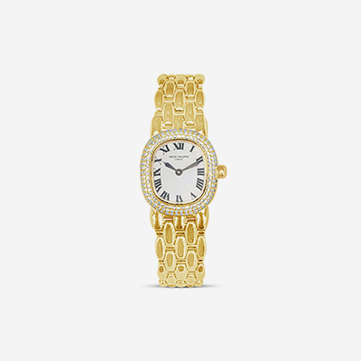 18kt patek philippe with diamond bezel
