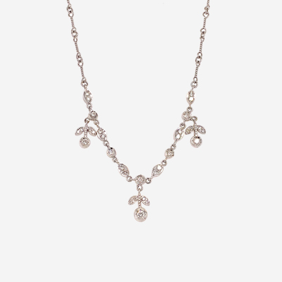 18kt white gold necklace with dangling diamond flowers