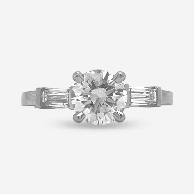 Platinum Round Center and Baguette Diamond Engagement Ring